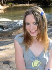 Cute teen Shelby flashes her perky tit while at the park down by the creek