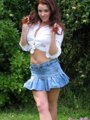 Brunette teen Heidi teases and strips outside on the lawn
