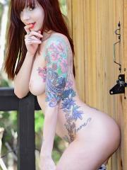 Ivy Snow warms up the weather in her shorts and small tank while she strips down and has some fun