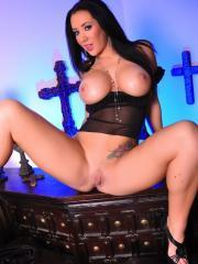 Pictures of Jayden Jaymes playing with her pussy in a goth office and loving the darkness.