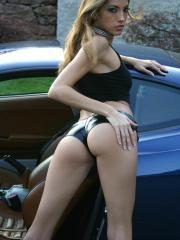 Jenna Haze shows off her sexy legs and body with a car