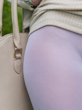 Redhead model Jeny Smith poses in her see-through leggings