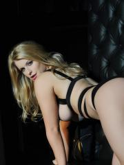 Blonde babe Jess Davies flaunts her perfect boobs in black lingerie