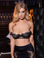 Jess Davies pulls down her black bra to show you her round boobs