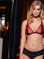 Blonde babe Jess Davies strips for you in a night club