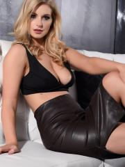 Beautiful blonde Jess Davies slowly strips out of her black bra and skirt