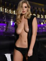 Blonde beauty Jess Davies strips out of her black dress in the night club