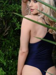 Blonde babe Jess Davies teases in her one-piece outside