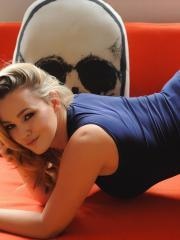 Jodie Gasson shows you her round natural boobs on the couch