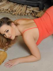 Jodie Gasson shows you her big natural boobs and long sexy legs by the fireplace