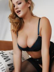 Blonde beauty Jodie Gasson dresses up in her hot black lingerie