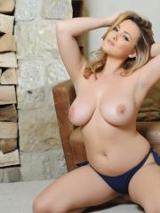 Jodie Gasson strips down to her blue thong at home