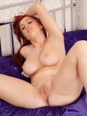Thicker amateur redhead Amy whips out her big natural tits