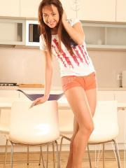 Seductive Tricia Teen gets herself off in the kitchen