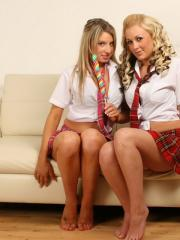 Lisa and Brooke have been bad at school as they strip each other out of their skimpy uniforms