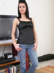 Stacy wants to be watched as she gets topless in front of the TV