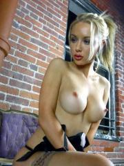 Pictures of Kayden Kross slipping out of her long black skirt