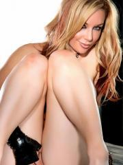 Blonde babe Kayden Kross strips down to her heels and toys her tight pussy