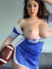 Busty hottie Kayla Kiss plays with her boobs and a football