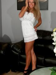 Blonde babe Kendra Rain strips off her white dress to tease in her panties