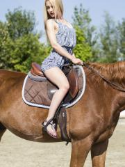 Blonde babe Khandi Rogers shares some pics of her horseback riding