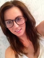 Lauren looking geeky, strips at home and invites you to play