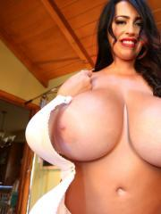 Busty babe Leanne Crow displays her ginormous boobs