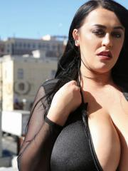 Leanne Crow flashes her boobs on the rooftop