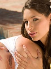 Beautiful girls Zafira and Stracy strip and pleasure each other outside