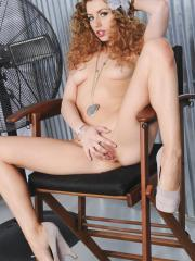Pictures of redhead girl Lexi Belle playing wtih her wet pussy