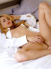 Pictures of Lexi Belle playing with her pussy in bed
