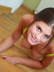 Pictures of Little Caprice being naughty on the stairs