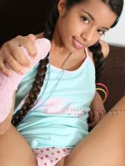 Hot latina girl Lupe offers herself up in pigtails and panties