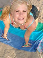 Pictures of hot blonde teen Little Summer having some fun on the beach