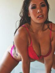 Busty Asian London Keyes spreads her pussy on a glass table.