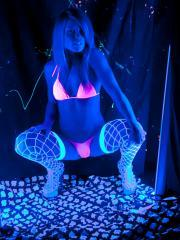 Blonde babe Madden teases in black light