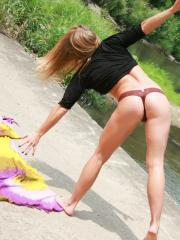 Blonde babe Madden has some fun sunbathing at the beach