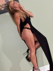 Blonde babe Madden poses on the red carpet in her black gown