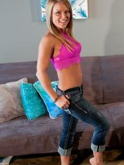 Blonde hottie Madden teaess in her pink halter and blue jeans