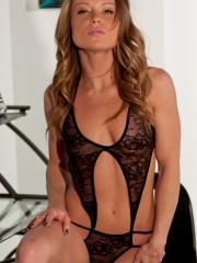 Blonde babe Madden teases in her black lace lingerie