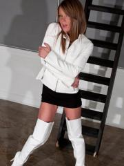 Blonde babe Madden teases in her white thigh-high boots