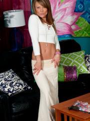 Blonde teen Madden strips and teases for you in her white pants and top