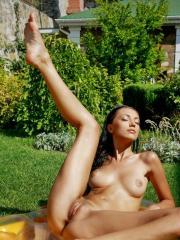 Beautiful girl Anna AJ tans naked in the sun