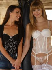 Pretty girls Lorena and Charlise strip out of their lingerie in a barn