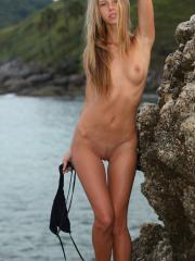 Blonde bombshell Katherine A displays her tight naked body outside