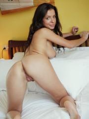 Pretty girl Gillian B shows you every inch of her body in bed