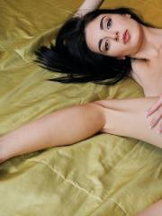 Skinny brunette Benita strips off her bra and panties to flaunt her tight body