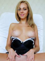 Gorgeous blonde Lija strips out of her black lingerie and offers you her hot tight pussy