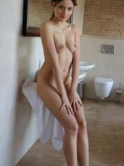 Brunette beauty Ardelia A drops her towel to expose her naked body
