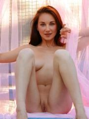 Redhead beauty Ledona invites you on a sexy naked picnic in the park